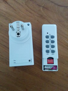 Remote and power socket with DIP-switch.